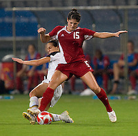 USWNT defender (15) Kate Markgraf tackles the ball away from Canadian forward (15) Kara Lang while playing at Shanghai Stadium.  The US defeated Canada, 2-1, in extra time and advanced to the semifinals during the 2008 Beijing Olympics in Shanghai, China.  hai, China.