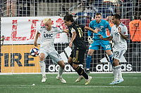 FOXBOROUGH, MA - AUGUST 4: Antonio Mlinar Delamea #19 of New England Revolution defending a Carlos Vela #10 of Los Angeles FC goal attempt during a game between Los Angeles FC and New England Revolution at Gillette Stadium on August 3, 2019 in Foxborough, Massachusetts.