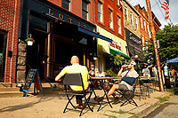 John and Adam Lubarski drink beers outside of Lot 17 in the Bloomfield neighborhood on Tuesday July 21, 2020 in Pittsburgh, Pennsylvania. (Photo by Jared Wickerham/Pittsburgh City Paper)