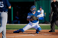 Dunedin Blue Jays catcher Riley Adams (21) looks to tag Reynaldo Rivera (35) during a Florida State League game against the Lakeland Flying Tigers on April 18, 2019 at Jack Russell Memorial Stadium in Clearwater, Florida.  Dunedin defeated Lakeland 6-2.  (Mike Janes/Four Seam Images)