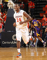 Jan. 2, 2011; Charlottesville, VA, USA; Virginia Cavaliers guard K.T. Harrell (24) smiles after making a basket during the game against the LSU Tigers at the John Paul Jones Arena. Mandatory Credit: Andrew Shurtleff-