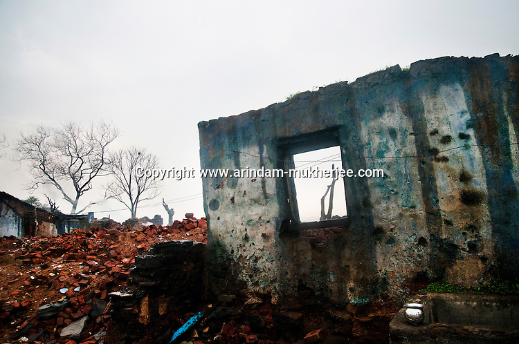 Wall of a deserted house at Ghannudi. 80% of this slum village at Ghannudi was destroyed by the coal mine fire. A huge coal mine fire is engulfing the city of Jharia from all its sides. All scientific efforts have gone in vain to stop this raging fire. This fire is affecting lives of people living in and around Jharia. Jharkhand, India. Arindam Mukherjee