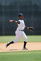 GCL Yankees East third baseman Sandy Mota (23) throws to first base during a game against the GCL Blue Jays on August 2, 2018 at Yankee Complex in Tampa, Florida.  GCL Yankees East defeated GCL Blue Jays 5-4.  (Mike Janes/Four Seam Images)