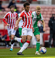 5th April 2021; Bet365 Stadium, Stoke, Staffordshire, England; English Football League Championship Football, Stoke City versus Millwall; Jacob Brown of Stoke City breaks away from Billy Mitchell of Millwall
