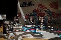 """France. Ile de France. Paris. The """"Presidential Game"""" for sale in a shop window. Figurines with pictures from french presidential election candidates: (Left to right) François Fillon for the right wing Les Républicains (LR), Jean-Luc Mélenchon for the leftist political movement """"Front de Gauche"""" (FG), François Asselineau for the right-wing Union Populaire Républicaine (UPR), Emmanuel Macron for the centrist party """"En Marche"""", Philippe Poutou for the party Nouveau Parti anticapitaliste (NPA). 21.04.17  © 2017 Didier Ruef"""