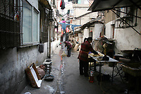 CHINA. Hubei Province. Wuhan. Daily life in the backstreets of Wuhan. Wuhan (population 4.3 million) is a sprawling city that sits on both sides of the Yangtze River. 2008