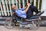 Man Alseep On His Motorbike