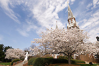 General views in spring of the Basilica of Belmont Abbey and the religious statue of Saint Benedict in Belmont, NC.