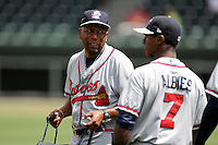 Batting coach Bobby Moore (1) of the Rome Braves, left, talks with Ozzie Albies (7) before a game against the Greenville Drive on Sunday, June 14, 2015, at Fluor Field at the West End in Greenville, South Carolina. Rome won, 5-2. (Tom Priddy/Four Seam Images)