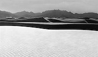 """""""Black Sand at White Sands"""" <br /> White Sands National Monument, New Mexico<br /> <br /> This photo was made by looking toward the sun at a carefully chosen angle so all of the dunes except the one in the foreground appear nearly black. The black and white photo was made at White Sands National Monument in New Mexico."""