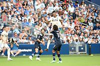 KANSAS CITY, KS - JUNE 26: Mark-Anthony Kaye #14 Los Angeles FC wins the header during a game between Los Angeles FC and Sporting Kansas City at Children's Mercy Park on June 26, 2021 in Kansas City, Kansas.