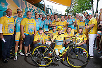 A yellow Team Astana gathers around Tour winner Vincenzo Nibali (ITA/Astana) before the start of the last stage into Paris.<br /> A special issue Yellow Specialized bike is presented to the champion, who preferres a 'not-too-bling' machine.<br /> <br /> 2014 Tour de France<br /> stage 21: Evry - Paris Champs-Elysées (137km)