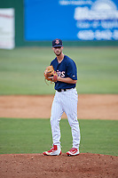 Elizabethton Twins relief pitcher Austin Schulfer (16) gets ready to deliver a pitch during a game against the Bristol Pirates on July 29, 2018 at Joe O'Brien Field in Elizabethton, Tennessee.  Bristol defeated Elizabethton 7-4.  (Mike Janes/Four Seam Images)