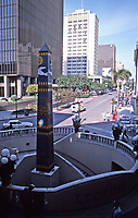 Horton Plaza:  Street scene with theater stairwell and obelisk in foreground. Photo Jan. 1987.