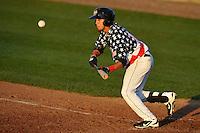 Erick Salcedo #14 of the Burlington Bees bunts against the Clinton LumbeKkings at Community Field  on July 3, 2014 in Burlington, Iowa. The LumberKings beat the Bees 6-5.   (Dennis Hubbard/Four Seam Images)