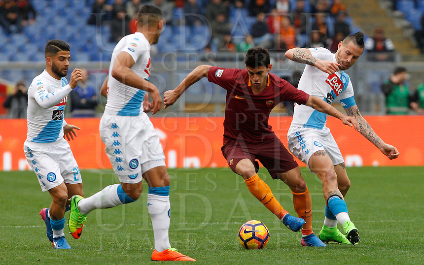 Roma's Diego Perotti, second from right, is challenged by Napoli's Lorenzo Insigne, left, Faouzi Ghoulam, second from left, and Marek Hamsik, during the Italian Serie A football match between Roma and Napoli at Rome's Olympic stadium, 4 March 2017. <br /> UPDATE IMAGES PRESS/Riccardo De Luca