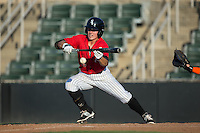 Bradley Strong (18) of the Kannapolis Intimidators lays down a bunt against the Greensboro Grasshoppers at Intimidators Stadium on July 17, 2016 in Greensboro, North Carolina.  The Grasshoppers defeated the Intimidators 5-4 in game two of a double-header.  (Brian Westerholt/Four Seam Images)