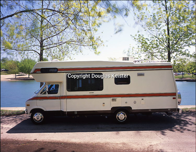 Grand Slam motorhomes were produced by Champion Home Builders from the early 1970s until 1980. Champion introduced a similar vehicle, the Flagship-Champion, in the early 1980s, but that model met the same fate as the Grand Slam and the last Flagship rolled out the door in 1985. This 1979 23-foot Grand Slam is a quality motorhome constructed with a steel frame, aluminum sides, and a one-piece fiberglass top. The noncorrosive fiberglass and aluminum have served this motorhome well. Over twenty-five years after it was manufactured, thanks to the care given by its owners, the body is still in showroom condition. The power plant is a Dodge 360 engine, which transfers its energy via a 3-speed automatic transmission to a 4.10 rear end with positraction. Owned by Ken and Lee Evensen. Photographed in Camp Dearborn, Michigan.