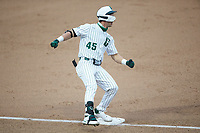 Hunter Baker (45) of the Charlotte 49ers stops at third base after hitting a triple against the Appalachian State Mountaineers at Atrium Health Ballpark on March 23, 2021 in Kannapolis, North Carolina. (Brian Westerholt/Four Seam Images)