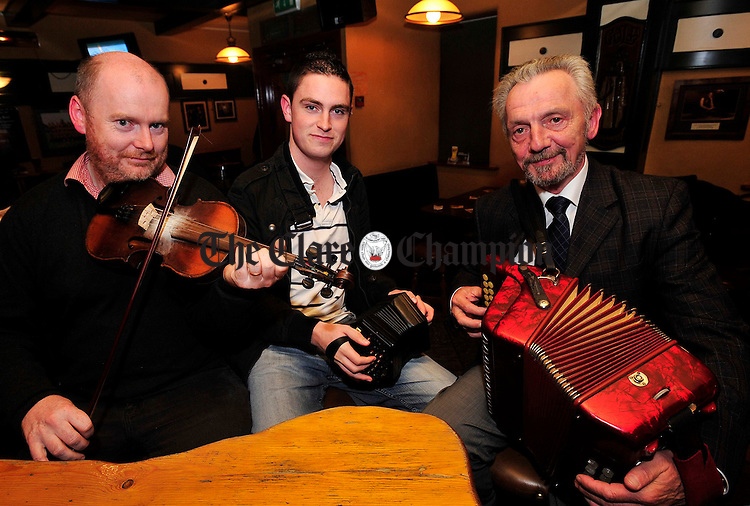 Musician Jack Talty, centre, pictured with Ennis Trad Festival P.R.O Kevin Finucane and Director Mike Butler at the launch of this year's festival. Photograph by Declan Monaghan