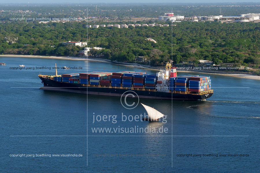 TANZANIA Daressalaam, bay and seaport, Pacific International Lines PIL container ship sailing to indian ocean, in contrast traditional arab dhow sailing boat