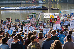 Powershift Rally in Pittsburgh 2013. In the background is a coal ship with a banner calling for support of American Jobs. Over six thousand young people from all over the country are converging in Pittsburgh, PA for Power Shift 2013, a massive training dedicated to bringing about a safe planet and a just future for all people. (Photo by: Robert van Waarden)