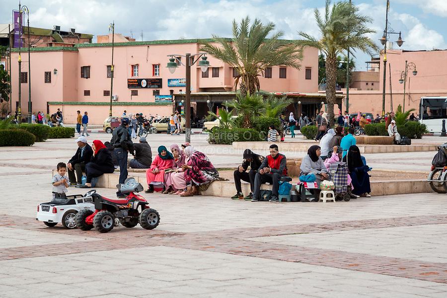 Marrakesh, Morocco.  Street Scene.  People Resting, Talking.
