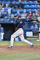 Asheville Tourists catcher Joel Diaz (5) swings at a pitch during a game against the Kannapolis Intimidators at McCormick Field on April 18, 2017 in Asheville, North Carolina. The Intimidators defeated the Tourists 2-1. (Tony Farlow/Four Seam Images)