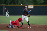AZL Giants Black second baseman Jose Rivero (2) attempts to turn a double play as William Rivera (9) slides into second base during an Arizona League game against the AZL Angels at the San Francisco Giants Training Complex on July 1, 2018 in Scottsdale, Arizona. The AZL Giants Black defeated the AZL Angels by a score of 4-2. (Zachary Lucy/Four Seam Images)