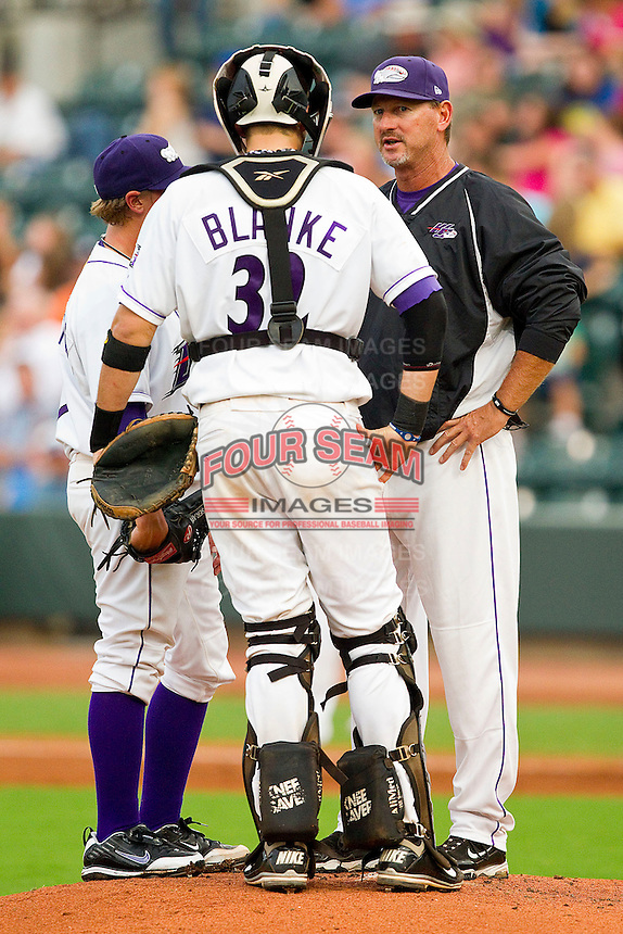 Winston-Salem Dash pitching coach Bobby Thigpen #37 has a chat on the mound with catcher Michael Blanke #32 and pitcher Joe Serafin #9 at BB&T Ballpark on August 5, 2011 in Winston-Salem, North Carolina.  The Dash defeated the Keys 10-0.   Brian Westerholt / Four Seam Images