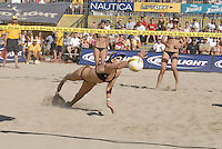 Huntington Beach, CA - 5/6/07:  Kerri Walsh dives for the ball during May-Treanor / Walsh's 21-13, 21-13 win over Branagh / Youngs in the championship match of the AVP Cuervo Gold Crown Huntington Beach Open of the 2007 AVP Crocs Tour..Photo by Carlos Delgado