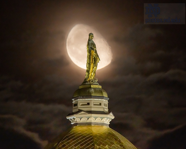 October 6, 2020; Moonrise behind Mary statue on the Golden Dome (Photo by Matt Cashore/University of Notre Dame)