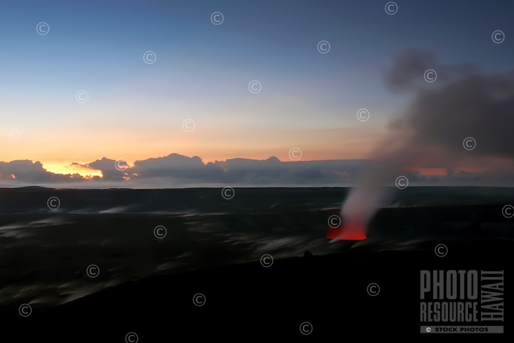 Lava and steam greet the sunrise at Kilauea Volcano's Halema'uma'u Crater, Hawai'i Volcanoes National Park, Big Island.