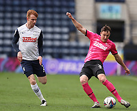 20th April 2021; Deepdale, Preston, Lancashire, England; English Football League Championship Football, Preston North End versus Derby County; Craig Forsyth of Derby County crosses the ball chased by Sepp van den Berg of Preston North End