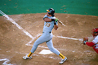 CINCINNATI, OH - Jose Canseco of the Oakland Athletics bats during Game 1 of the 1990 World Series against the Cincinnati Reds at Riverfront Stadium in Cincinnati, Ohio in 1990. Photo by Brad Mangin