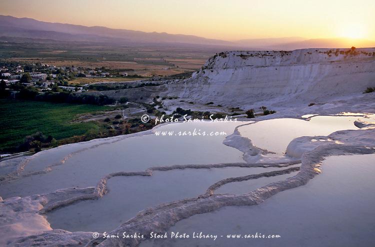 Sunset over the famous 'cotton castle' pools of Pamukkale, Denizli, Turkey.