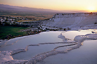 Sunset over the famous 'cotton castle' pools of Pamukkale, Denizli, Turkey.