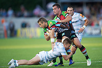20130803 Copyright onEdition 2013 ©<br />Free for editorial use image, please credit: onEdition.<br /><br />Jeremy Manning of Harlequins 7s is tackled by Jack Walsh of London Irish 7s as Dave Ward of Harlequins 7s supports during the J.P. Morgan Asset Management Premiership Rugby 7s Series.<br /><br />The J.P. Morgan Asset Management Premiership Rugby 7s Series kicks off for the fourth season on Thursday 1st August with Pool A at Kingsholm, Gloucester with Pool B being played at Franklin's Gardens, Northampton on Friday 2nd August, Pool C at Allianz Park, Saracens home ground, on Saturday 3rd August and the Final being played at The Recreation Ground, Bath on Friday 9th August. The innovative tournament, which involves all 12 Premiership Rugby clubs, offers a fantastic platform for some of the country's finest young athletes to be exposed to the excitement, pressures and skills required to compete at an elite level.<br /><br />The 12 Premiership Rugby clubs are divided into three groups for the tournament, with the winner and runner up of each regional event going through to the Final. There are six games each evening, with each match consisting of two 7 minute halves with a 2 minute break at half time.<br /><br />For additional images please go to: http://www.w-w-i.com/jp_morgan_premiership_sevens/<br /><br />For press contacts contact: Beth Begg at brandRapport on D: +44 (0)20 7932 5813 M: +44 (0)7900 88231 E: BBegg@brand-rapport.com<br /><br />If you require a higher resolution image or you have any other onEdition photographic enquiries, please contact onEdition on 0845 900 2 900 or email info@onEdition.com<br />This image is copyright the onEdition 2013©.<br /><br />This image has been supplied by onEdition and must be credited onEdition. The author is asserting his full Moral rights in relation to the publication of this image. Rights for onward transmission of any image or file is not granted or implied. Changing or deleting Copyright information is illegal a