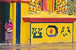 Latin America, Guatemala, Western Highlands, San Andres Xecul, Girl Waiting at Church Door