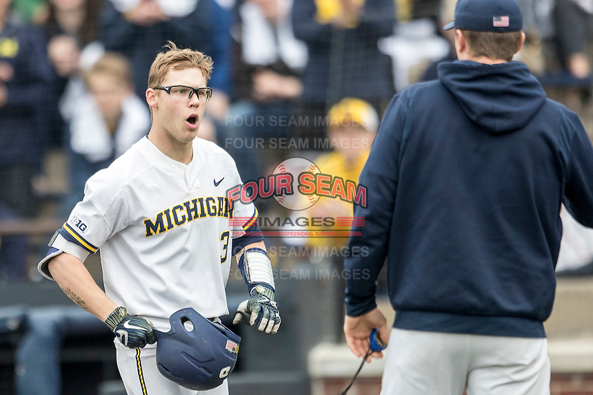 Michigan Wolverines designated hitter Dominic Clementi (13) celebrates after his first inning home run against the Maryland Terrapins on April 13, 2018 in a Big Ten NCAA baseball game at Ray Fisher Stadium in Ann Arbor, Michigan. Michigan defeated Maryland 10-4. (Andrew Woolley/Four Seam Images)