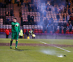 Some pyro on the pitch pointed out by Celtic keeper Jordan Hart