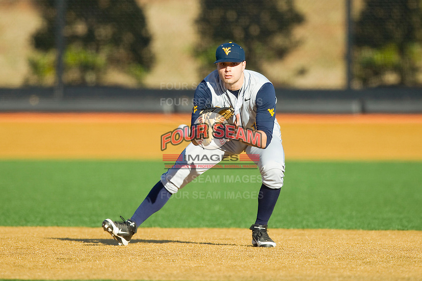 West Virginia Mountaineers first baseman Ryan McBroom (13) fields a ground ball against the Wake Forest Demon Deacons at Wake Forest Baseball Park on February 24, 2013 in Winston-Salem, North Carolina.  The Demon Deacons defeated the Mountaineers 11-3.  (Brian Westerholt/Four Seam Images)