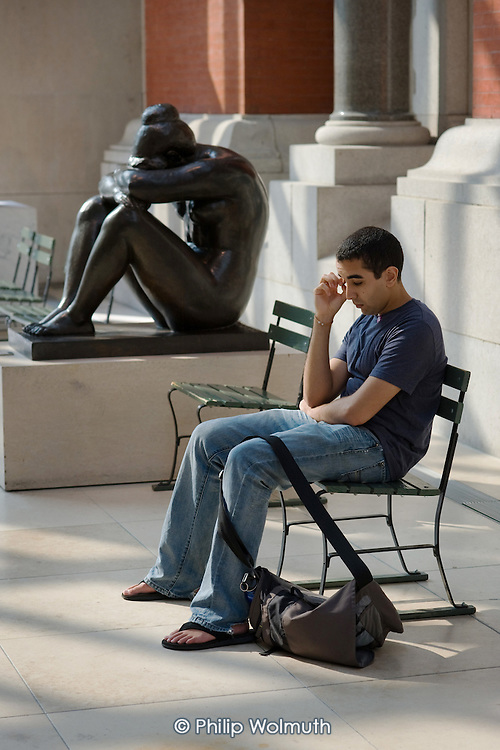 Visitor and bronze by Aristide Maillol in the sculpture gallery of the Metropolitan Museum of Art, Manhattan, New York.