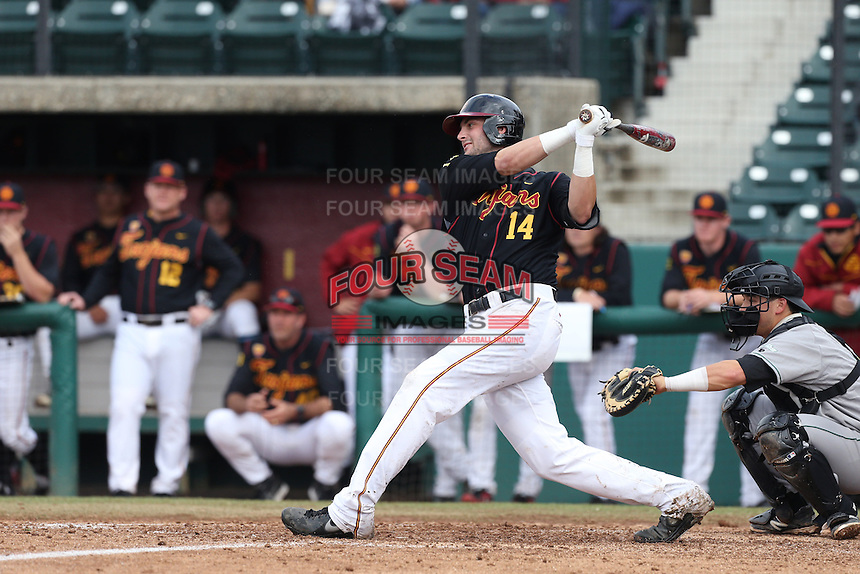 Vahn Bozoian #14 of the USC Trojans bats against the Cal Poly Mustangs at Dedeaux Field on March 2, 2014 in Los Angeles, California. Cal Poly defeated USC, 5-1. (Larry Goren/Four Seam Images)