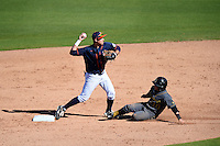 Cal State Fullerton Titans infielder Jake Jefferies (4) throws to first as Einar Muniz (10) slides in during a game against the Alabama State Hornets on February 14, 2015 at Bright House Field in Clearwater, Florida.  Alabama State defeated Cal State Fullerton 3-2.  (Mike Janes/Four Seam Images)