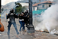 BOGOTA, COLOMBIA - MAY 05: A protester clashes with police during national strike on May 5, 2021 in Bogota, Colombia. Despite that the ruling party announced withdrawal of the unpopular bill for a tax reform and the resignation of the Minister of Finances, social unrest continues after a week. The United Nations human rights office (OHCHR) showed its concern and condemned the riot police repression. Ongoing protests take place in major cities since April 28. (Photo by Leonardo Munoz/VIEW press/Corbis via Getty Images)