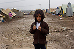 DOMIZ, IRAQ: A young Syrian refugee poses for a photo in the Domiz refugee camp in the Kurdish region of northern Iraq...The semi-autonomous region of Iraqi Kurdistan has accepted around 60,000 refugees from war-torn Syria. Around 20,000 refugees live in the Domiz camp which sits 60 km from the Iraq-Syria border...Photo by Younes Mohammad/Metrography
