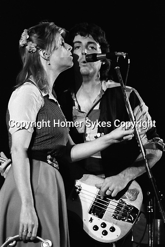 """Paul and Linda McCartney Wings Tour 1975. Linda during a rehearsal in the Elstree rehearsal studio. London. England.. The photographs from this set were taken in 1975. I was on tour with them for a children's """"Fact Book"""". This book was called, The Facts about a Pop Group Featuring Wings. Introduced by Paul McCartney, published by G.Whizzard. They had recently recorded albums, Wildlife, Red Rose Speedway, Band on the Run and Venus and Mars. I believe it was the English leg of Wings Over the World tour. But as I recall they were promoting,  Band on the Run and Venus and Mars in particular."""
