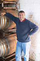 Eduardo Pisano one of the brothers Pisano in the barrel aging cellar. Bodega Pisano Winery, Progreso, Uruguay, South America