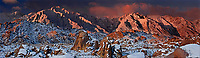 902000010 winter sunrise during a clearing snowstorm lighting mount russell lone pine peak and mount whitney in the eastern sierras with snow covered granite boulders glowing red in the early morning light in the bureau of land management protected lands called the alabama hills in kern county california